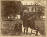 James, Marguerite and Bernard Holes in front of home, Fargo, N.D.