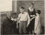 Dr. Kilbourne doing immunizations for diphtheria at the Child Health Demonstration Center, Fargo, N.D.