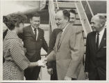 Hubert Humphrey shaking hands with woman on airport tarmac