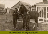 J. Frank Cowen and son Leslie, with horse, Tower City, N.D.