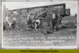 Men slaughtering starving calves, Hettinger, N.D.