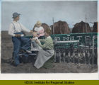Oxen pulling a grain drill in pioneer days : a welcome break in a long day, stopping for lunch and a