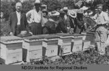 Demonstration with bees at Will Richmond apiary, Grand Forks, N.D.