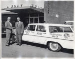 Earl Reineke with man outside WDAY headquarters, Fargo, N.D.