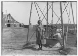 Inga Arlien by farm windmill, Pekin, N.D.