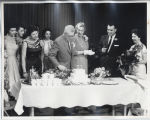 Earl C. Reineke cutting the WDAY-Radio's 37th Birthday Cake