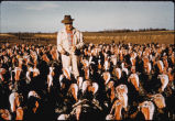 Man standing in flock of turkeys