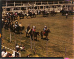 Indian riders at start of rodeo held at Sanish, N.D.