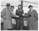 Homer George being congratulated on his WDAY TV tower climb, Amenia, N.D.