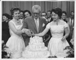 Verna Newell, Earl Reineke and Lois Leppart cutting WDAY 38th Birthday Cake