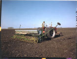 Spring seeding time with power drill, the drill is equiped with fertilizer attachment, John Scott...