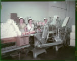 Girls operating butter cutting & wrapping machine at Mandan Creamery & Produce Assn., Mandan, N.D.