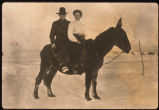 Anna Chermak and August Swanson riding mule.