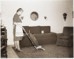 Woman Vacuuming, West Fargo, N.D.