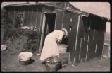 Randi Garmann washing clothes outside her homestead shack