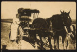 Randi Garmann beside horse-drawn buggy