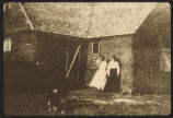 Eunice Divet Glynn and sister Edith Divet by sod house on their homestead, Grant County, N.D.