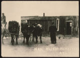 Karoline Holen outside her homestead shack, Williams County, N.D.