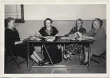 Four women at North Dakota Federation of Women's Clubs convention, Grafton, N.D.