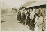 Boys standing along side of road, Korea