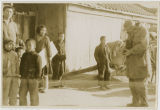 A soldier photographing a Korean family