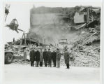 Group in front of demolished building