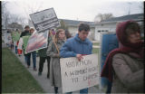 Anti-abortion protesters marching with signs