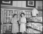 Two women in men's wear department, Herbst Department Store, Fargo, N.D.