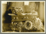 Open casket with deceased woman lying in state