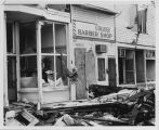 Damage to the College Grocery Store, College Barber Shop, and College Inn after the tornado on...