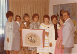 N.D. Gov. Art and Grace Link with committee during embroidered chair cover presentation