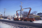 N.S.P. cherry picker trucks fixing electric lines, Fargo, N.D.