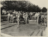 Men laying new street car line, Moorhead, Minn.