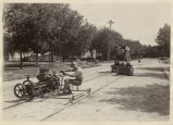 Men repairing street railroad tracks on 8th Avenue S., Moorhead, Minn.